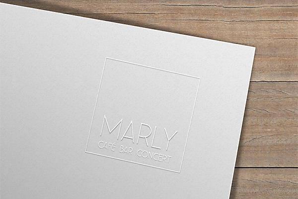 cafe-marly-logo-praegung-auf-weissem-papier